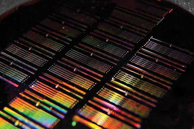 This working integrated photonic wafer created by Rochester Institute of Technology researchers contains thousands of integrated photonic devices including waveguides, filters, couplers, modulators and more.