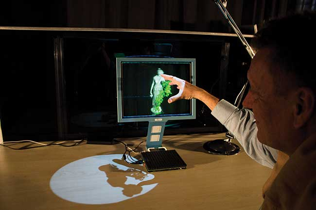 Glasses-free 3D display technology could allow people to share and interact with a scene (above and at right).