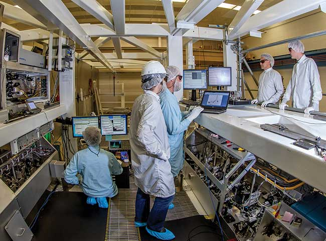 A group of technicians, engineers and scientists validate the performance of the High Contrast ARC Front End (HCAFE) AFECT (ARC Front End Compressor Table) system at the National Ignition Facility at Lawrence Livermore National Laboratory in California.