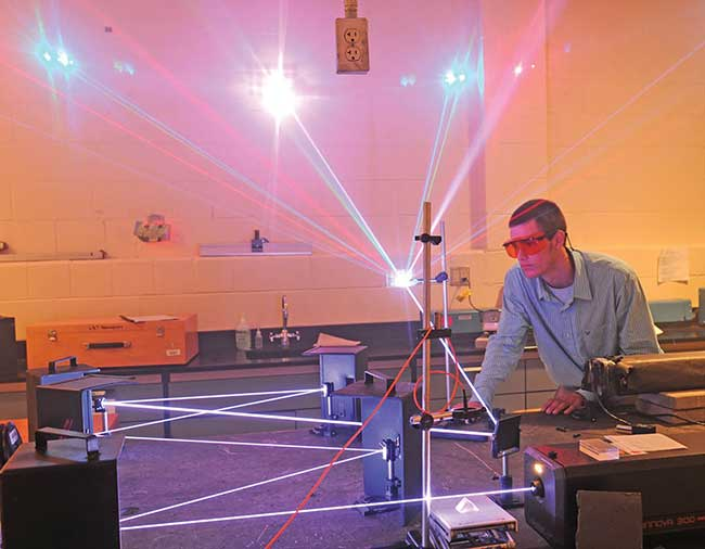 John-Kevin Frazee demonstrates how an argon-krypton laser can be used in light shows while a student at Central Carolina Community College in 2012.