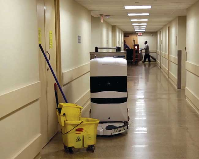 An autonomous mobile robot navigates around an obstacle.