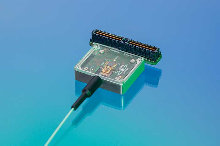 A standard PIC package for fiber sensing interrogation, including stabilized fiber coupling and thermal control.