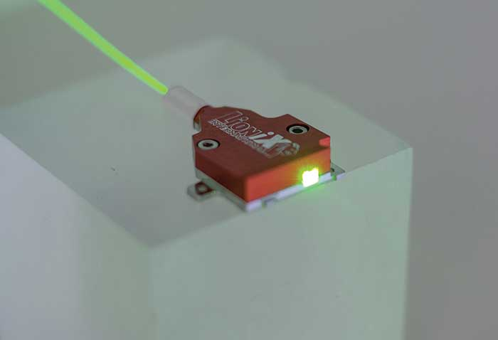 Packaged PIC with optical fiber input and free space output.