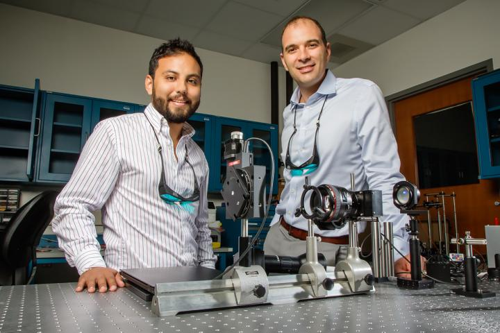 Professor Viktor Gruev (l) and Missael Garcia (r), camera based on visual system of mantis shrimp. University of Illinois.