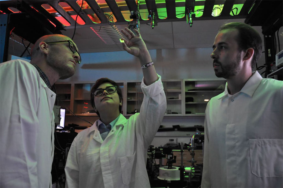 UC Riverside's Nathaniel Gabor (left) is seen here in his Quantum Materials Optoelectronics lab with his graduate students Fatemeh Barati (center) and Max Grossnickle. Building an efficient photodetector based on quantum mechanics.