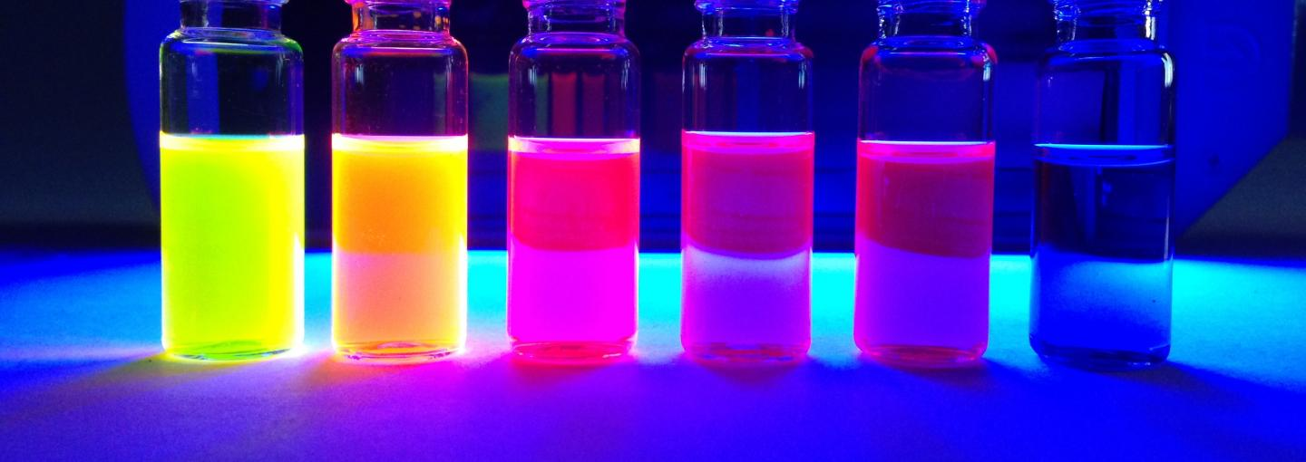Rhodamine dyes synthesized in Lavis Lab fluorescing under UV illumination, HHMI.