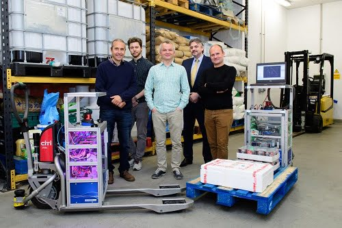 Pictured L-R with the forklift prototypes is Professor Tom Duckett, Principal Investigator for the University of Lincoln's ILIAD team, Dr Martin Magnusson from Örebro University, and the rest of the team at Lincoln, Dr Grzegorz Cielniak, Mark Swainson, and Dr Marc Hanheide.