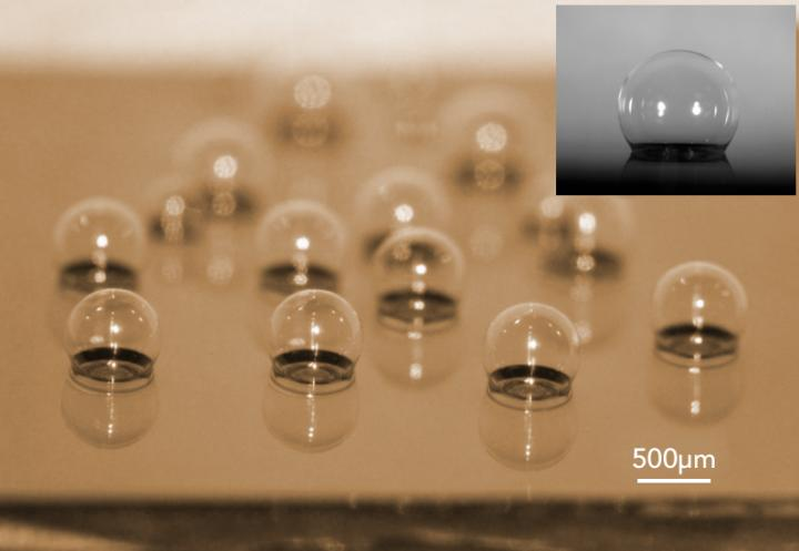A chip-scale glass microspherical shell sensor array blown on a silicon substrate. Insert is a near-perfect spherical shell.