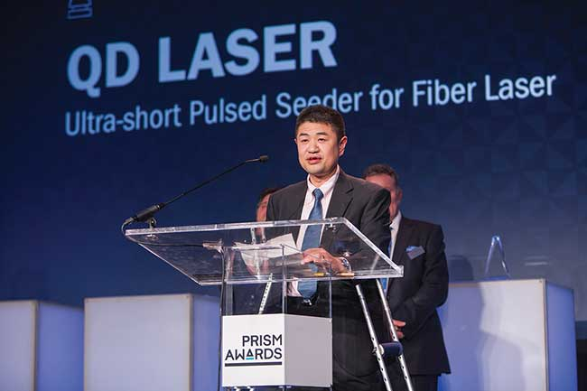 Engineers from QD Laser accept the 2017 Industrial Laser award for their Ultra-short Pulsed Seeder for Fiber Laser.