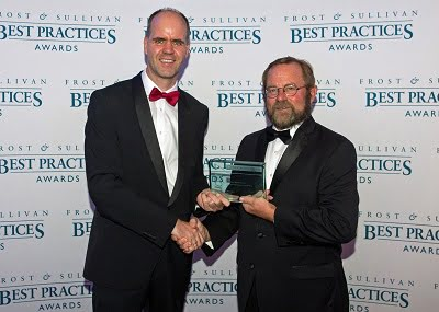Michael Heckmeier, Head of the Display Materials business unit of Merck KGaA, Darmstadt, Germany, on the left, receives the award for Merck. On the right: Jeff Frigstad, Global Senior Vice President Best Practices at Frost & Sullivan.
