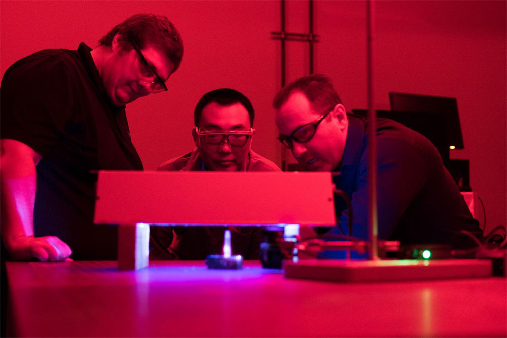 From left, Rice University research scientist Christopher Pennington, graduate student Bo Jiang and Angel Martí, an associate professor of chemistry and bioengineering, run an amyloid beta experiment in the Martí lab.