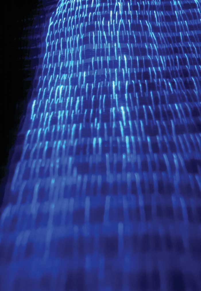 Where polymer optical fibers are woven into the fabric and connected to LEDs, the fabric shines at a therapeutic wavelength.