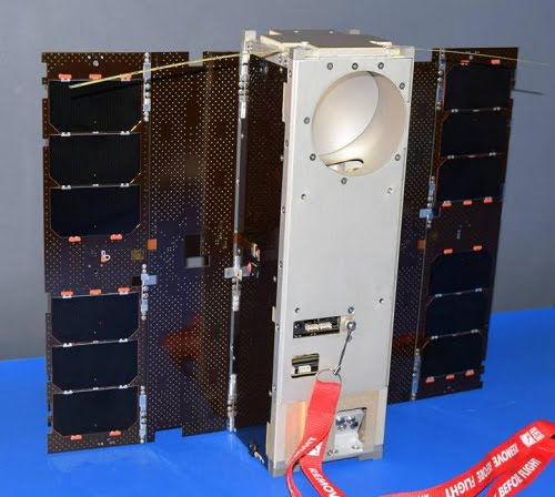 The Microwave Radiometer Technology Acceleration (MiRaTA) satellite, a 3U CubeSat, is shown with solar panels fully deployed, flanking the body of the spacecraft, which has a circular aperture at the top for the microwave radiometer antenna, used for atmospheric science measurements.