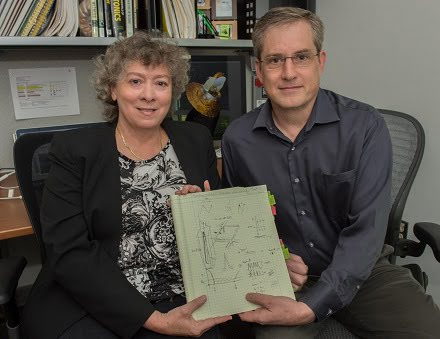 Christine Jhabvala and Ed Wollack hold the sketch of the absorber technology they created.