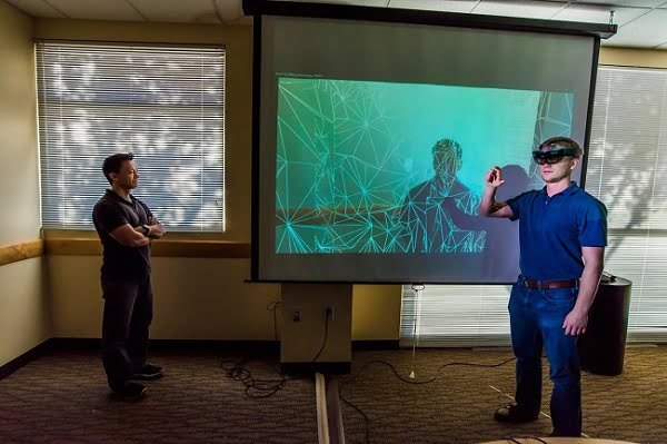Tam Le, left, and Todd Noel use augmented reality headsets to help train physical security personnel from around the world.