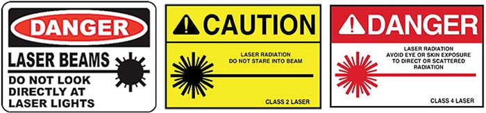 "An evolution in laser safety signage over the years. The oval ""Danger"" sign (left) was used from 1973 through 1993, whereas by 2000 the signage incorporated an exclamation mark and the triangle."