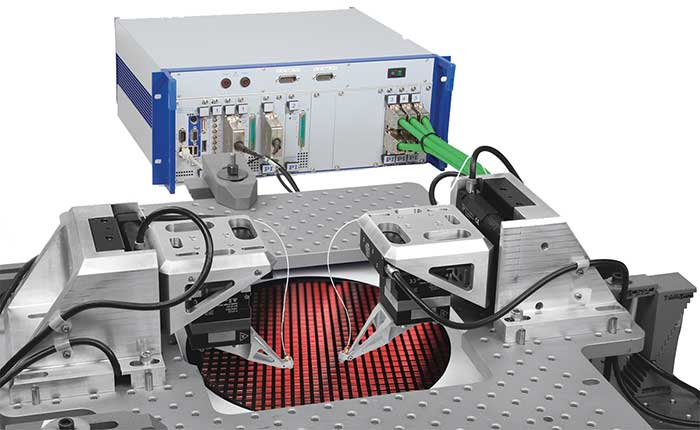 A fast multichannel photon alignment (FMPA) system for double-sided probing of on-wafer waveguide devices.