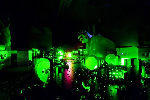 A scientist at work in the Extreme Light Laboratory at the University of Nebraska-Lincoln, where physicists were able to change the way photons scatter from electrons.