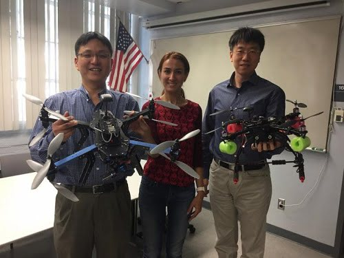 University of Arizona systems engineering researchers Young-Jun Son (left), Sara Minaeian and Jian Liu are using these unmanned aerial drones to design an autonomous border patrol surveillance system.