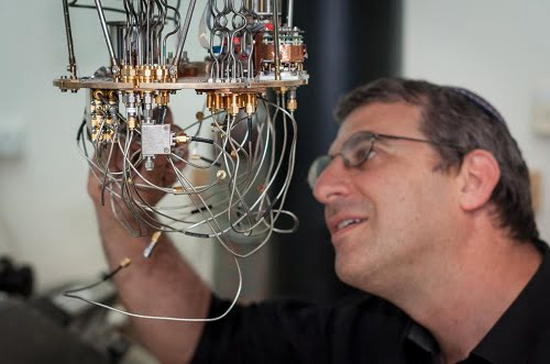 Professor Nadav Katz studies a low temperature setup for testing superconducting detectors at the Hebrew University's Quantum Information Science Center.