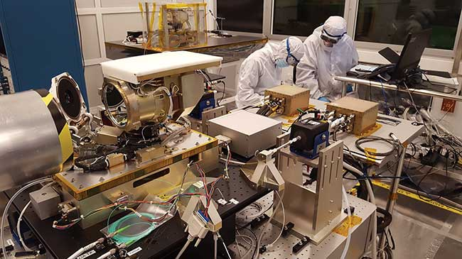 Work is performed on an optical module of the Laser Communication Relay Demonstration (LRCD) optical module.
