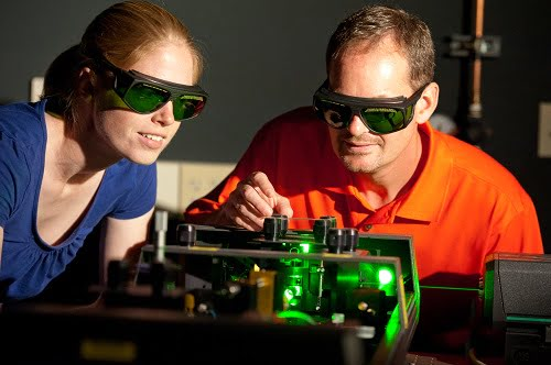 Prof. John Ballato and student tuning a laser used in this research.