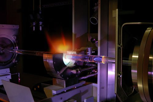A modified chemical vapor deposition (MCVD) lathe at Clemson University used to make the glass preforms that are subsequently drawn into optical fiber.