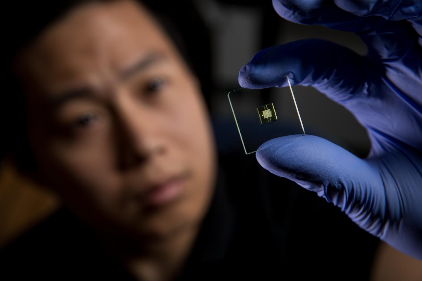 BYU Ph.D. student Hua Gong holds a 3D printed microfluidic device.