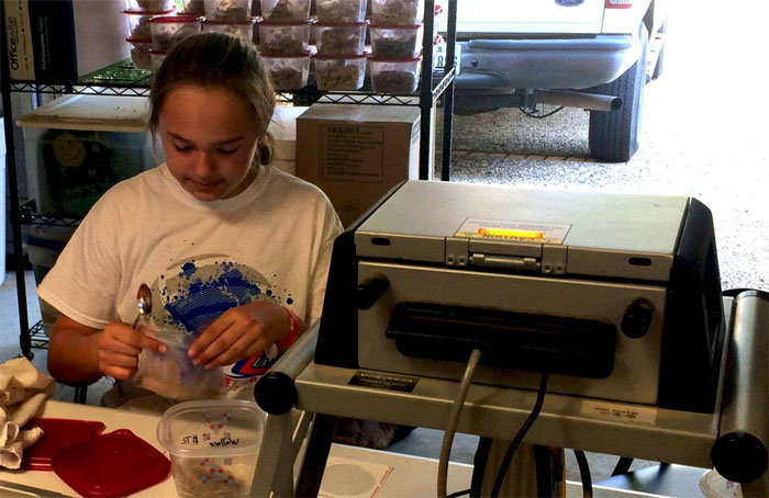 Middle schooler using portable xray fluorescence spectrometry. Texas Tech University.