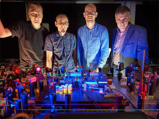 Creating optical wells for super-photons. (from left) Tobias Damm, Frank Vewinger, David Dung and Professor Dr. Martin Weitz, University of Bonn.