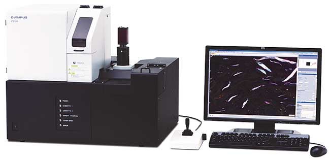 Birefringent plastic that disintegrated in a knee replacement is shown on the monitor of the Olympus VS120 virtual microscopy system