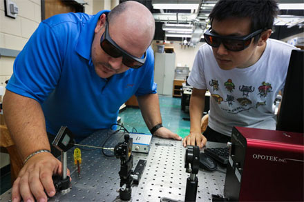 Laser ablation and vacuum capture system for fingermark sampling, Louisiana State University. Fabrizio Donnarumma (l) and Fan Cao (r).