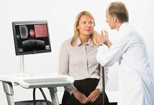 VivoSight OCT scanner being used to image a patient's skin.