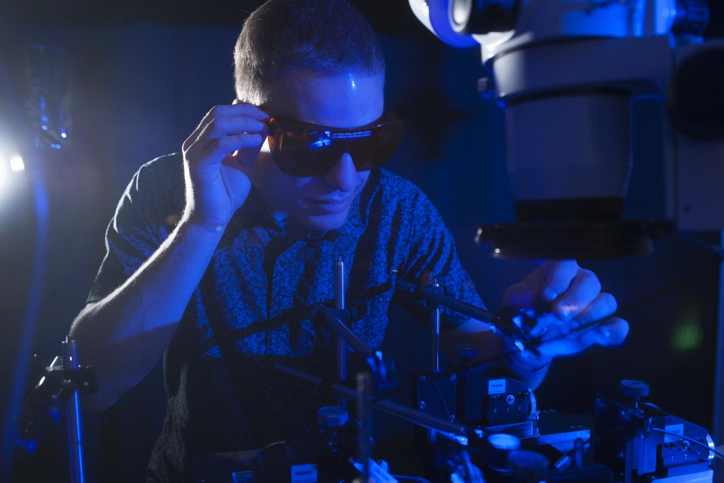 NSF Graduate Research Fellow Erik Anderson tests the conversion of blue light to electricity with a new higher efficiency rectenna design. Optical rectenna, Georgia Tech.