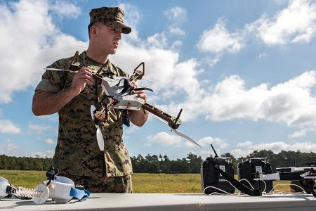 Lance Cpl Nicholas Hettinga, 2nd Tank Battalion, 2nd Marine Division, prepares to pilot a 3-D printed unmanned aircraft system, or drone, during a Sept. 27, 2017, test flight at Camp Lejeune, N.C. Courtesy of David McNally, US Army.