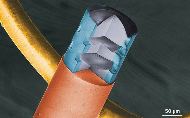Figure 4. Colored scanning electron microscopy (SEM) image of a multilens assembly on the tip of a fiber.