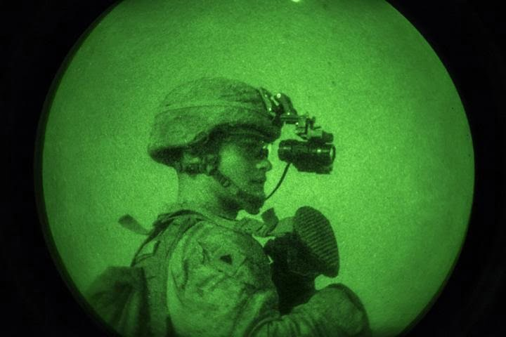 US Marine Corps Cpl. Benjamin Harris, a rifleman with 3rd Battalion 7th Marine Regiment attached to Special Purpose Marine Air-Ground Task Force, Crisis Response-Central Command (SPMAGTF-CR-CC), looks through his night ocular device. Courtesy of Gabino Perez/USMC.