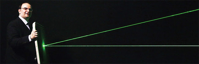 Figure 3. In development at Metamaterial Technologies Inc. (MTI), a new optical metamaterial called metaAIR filters out harmful green laser strikes for vision protection in military and aviation applications (a) (top). MTI founder and CEO George Palikaras holds an aircraft windscreen coated with metaAIR  to deflect green laser light (b)(bottom). Courtesy of MTI.