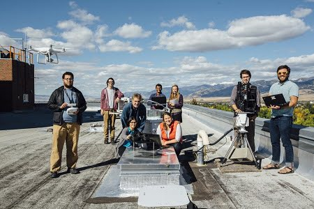 Electrical engineering professor Joe Shaw, third from left, is shown on the roof of Cobleigh Hall in Sept. 2018 with MSU students who have contributed to his optics research. Courtesy of MSU/Adrian Sanchez-Gonzalez.