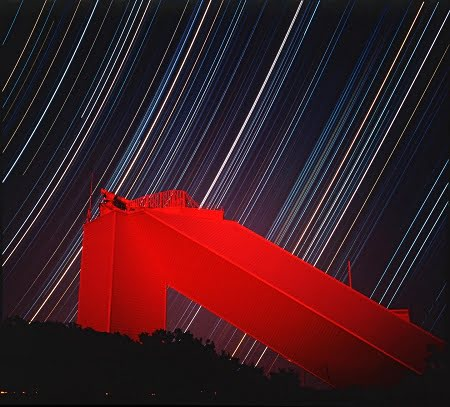 This is a nine-hour exposure of the McMath-Pierce Solar Facility on Kitt Peak. The normally white building appears red due to high altitude haze following the 1991 eruptions of Mount Pinatubo. Courtesy of Bill Livingston/NSO/AURA/NSF.