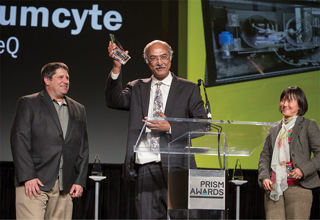Bidhan Chaudhuri, founder and chief technology officer of Quantumcyte, accepts the 2018 Prism Award in the Life Science and Instrumentation category along with John Butler, CEO (left), and Bernadine Lim, vice president of international business development. Images courtesy of SPIE.