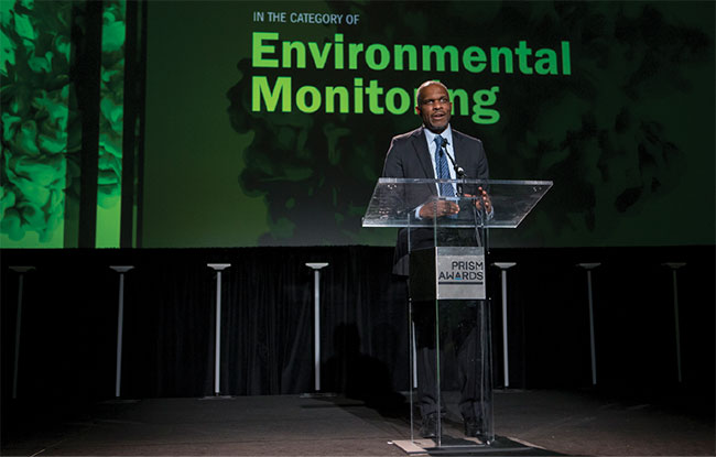 Darius Sankey, venture capitalist and co-president at Ocean Tomo, presents the 2018 Prism Award in the Environmental Monitoring category.
