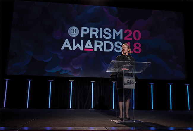 Pamela Robertson, industry program manager at SPIE, speaks at the 2018 Prism Awards.