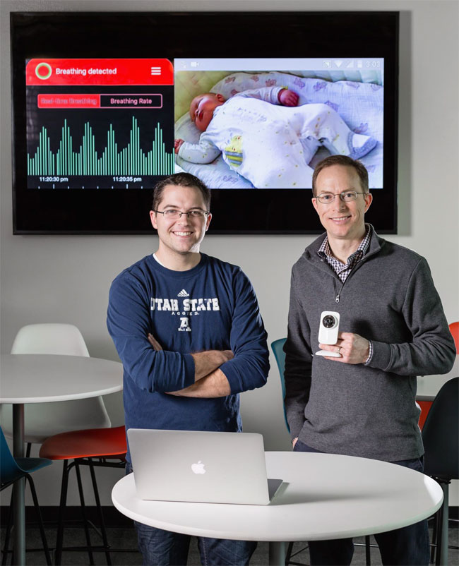 USU alumnus and CEO, Photorithm Inc. Nate Ruben (left) and Professor Jake Gunther, right, remote sensor for monitoring heart and breathing rates. Utah State University.
