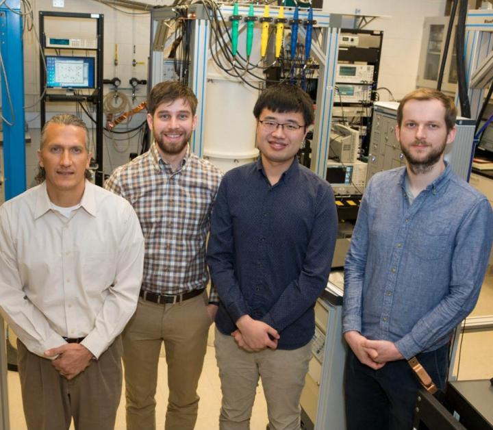 The researchers at Princeton University included (left to right): Jason Petta, professor of physics, David Zajac, graduate student, Xiao Mi, graduate student and Stefan Putz, postdoctoral researcher. Silicon qubits, spin-photon interface in silicon.
