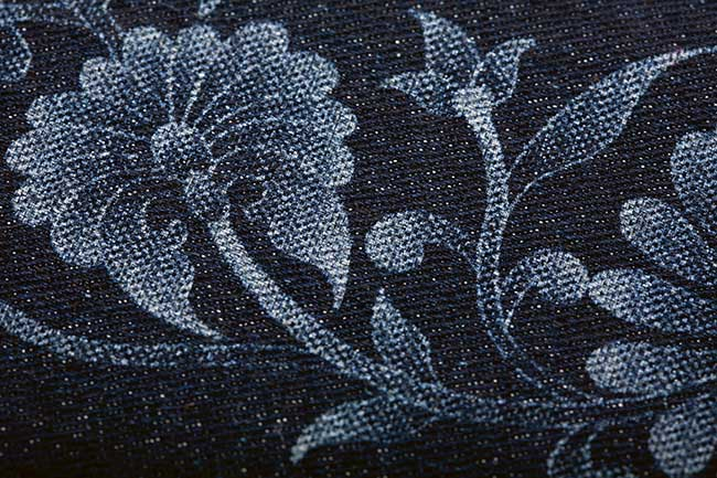 Flower pattern in denim produced by a laser.