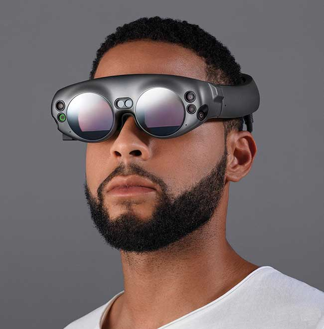 The Magic Leap One AR headset projects holographic virtual images and audio to rounded lenses from an attached computer called Lightpack, about the size of a CD player.