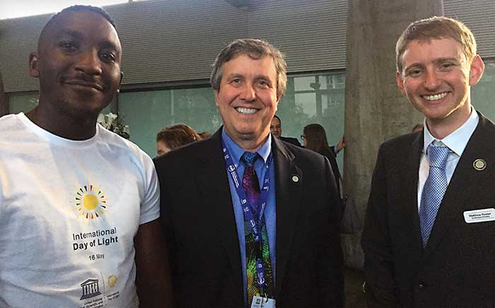 International Day of Light 2018; (left to right) Gilles Freddy Feutmba, Ghent University; SPIE CEO Kent Rochford; and Matthew Posner, University of Southampton. Both Feutmba and Posner are on the SPIE Student and Early Career Professional Ad Hoc Committee.