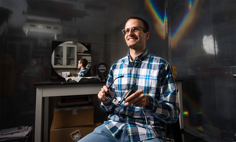 Aaron Bauer, a senior research engineer at the University of Rochester's Center for Freeform Optics, has developed a process that will speed the design and development of optical devices that use freeform surfaces.