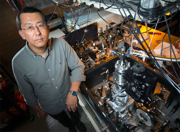 Jigang Wang of Iowa State and the Ames Laboratory led experiments that switched on a hidden state of matter in a superconductive alloy. Courtesy of Christopher Gannon/Iowa State University.